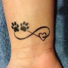 10 Most Beautiful Pet Memorial Tattoos - A minimalist pet memorial tattoo combines the symbol for infinity with two paw prints and a heart. Tattoos Infinity, Infinity Tattoo Designs, Cat Tattoo Designs, Pet Tattoo Ideas, Heart With Infinity Tattoo, Toe Tattoos, Print Tattoos, Small Tattoos, Tatoos