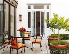 A spacious courtyard connects to the ballroom and breakfast room. - Photo: Emily Jenkins Followill / Design: Carolyn Griffith