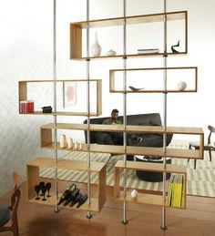 Room divider made of adjustable bamboo boxes supported by aluminum poles