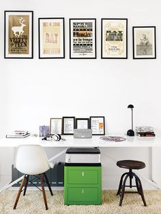 In their modern Austin home, Sam Shah and Anne Suttles hung a collection of vintage posters abovea Cbox file cabinet and a table from Blu Dot used as a desk. The rug is a Photon.