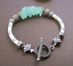 Genuine surf tumbled sea glass bracelet with sterling curved tubes. Stone Street Studio