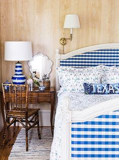 Another bedroom is decorated with a country-chic Gustavian bed upholstered in a gingham fabric.