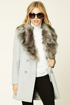 A woven wool-blend coat featuring a removable faux fur collar, a notched collar, a double-breasted button-down front, long sleeves, baste-stitched on-seam pockets, and front princess seams.