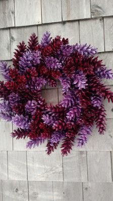 This wreath is just so sweet! With a fresh berry red and a beautiful lavender. My wreaths are so sturdy, each cone individually wrapped twice. Please feel free to message me with any idea! Or if you need a different size. This measurres 18 from side to side.