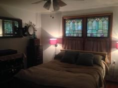 The stained glass windows are in an Arts & Crafts style. The pattern looks like a wheat motif. They are from a home in Yukon, OK. Shabby Chic Cottage, Stained Glass Windows, Natural Wood, Glass Art, Arts And Crafts, Bed, Pattern, Room, Furniture
