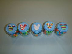 Homemade DIY Mickey Mouse party favor- 2.5oz baby bottles painted with non-toxic acrylic paint. Mickey Mouse stickers from Toys R Us, filled with colorful M.