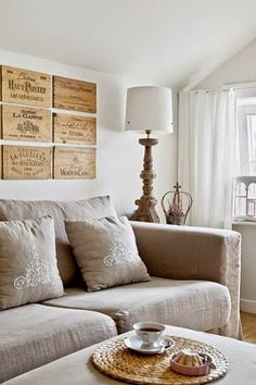 champagne crate fronts used as wall decor