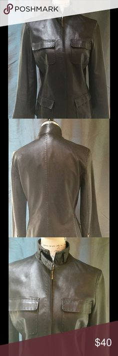 Tahari Brown Leather Jacket Tahari Brown Leather Jacket&-Beautiful Stitch detail, zipper detailed sleeves- Front zipper closure- Excellent Condition- 100%Leather She'll- lining Polyester Tahari Jackets & Coats Blazers