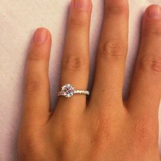 THIS ONE holy dream. 1.31 carat diamond, 6 prongs, and a diamond band. Yeah this is perfect.