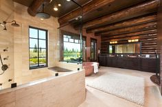 The main home includes six bedrooms and 10 bathrooms. A 3,850-square-foot guesthouse includes an additional four bedrooms, Mr. Hussey said. The master bathroom, with travertine stone flooring and wood trusses, is pictured.