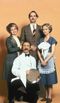 Iconic: John as Basil with co-stars Prunella Scales as Sybil Fawlty, Andrew Sachs as Manuel and Connie Booth as Polly Sherman in the original Seventies series British Tv Comedies, Classic Comedies, British Comedy, British Actors, English Comedy, British Celebrities, British Humor, British Men, Comedy Tv Shows