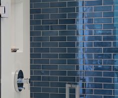 One shower wall bold color tile. glossy 2x6 in G19.2 Island Blue. Heath Ceramics