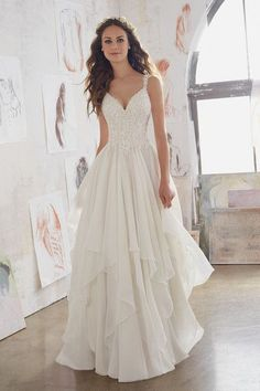 Vintage wedding dress idea - A-line gown with lace appliqués and chiffon skirt. Style 5512 by @morileewedding.