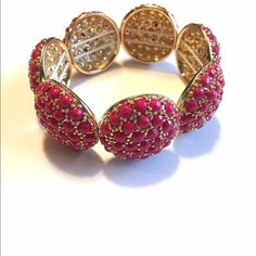 Banana Republic Pink and Gold Bracelet Great way to add a pop of color to your outfit!  Beautiful pink and gold bracelet from Banana Republic.  Stretchy band so it will fit just about anyone!  Bundle for a discount! Banana Republic Jewelry Bracelets