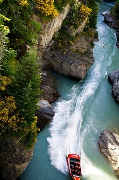 The Shotover River, an old gold-mining stream near Queenstown, New Zealand, known as the adventure capital of the South Island.