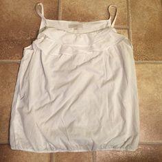 LOFT L Ruffle Neckline Cotton Tank Elastic Waist LOFT L Ruffle Neckline Cotton Tank Elastic Waist. The elastic in waistline is twisting, but it is not noticeable when wearing in my opinion. Great, versatile piece! LOFT Tops Camisoles