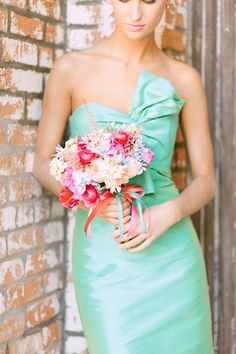 Adorable mint bridesmaid dress with a bow. Photo by Ben Q Photography. www.wedsociety.com #bow #mint