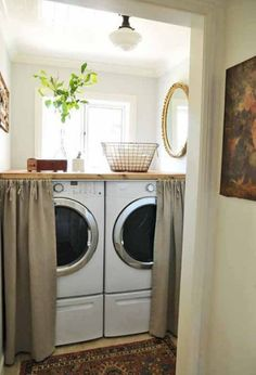 I LOVE THIS- 20 small laundry room ideas for front loaded washer and dryers. I want a cute little curtain in front of my washer and dryer.
