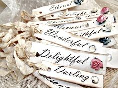 don't know what we would use these for...possible escort cards, labels for a candy bar or dessert table...they just look so cute and romantic!