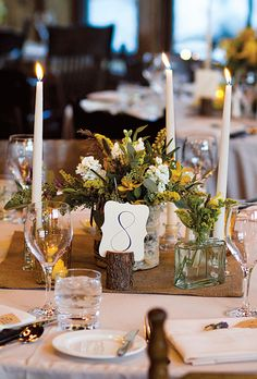 tables featured burlap table runners and arrangements of wildflowers in brass spittoons, copper pitchers, glass medicine jars, and other antique vessels sourced by the bride on @eBay and @Etsy (IN Photography)