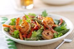 Shrimp stir-fry or tossed salad? This Stir-Fry Shrimp Salad recipe is a bit of both! We combined stir-fried shrimp with crisp greens, carrots, peppers and onions for a simple main dish salad. Salad Recipes Gluten Free, Shrimp Salad Recipes, Shrimp Dishes, Fish Recipes, Asian Recipes, Healthy Recipes, Shrimp Stir Fry, Fried Shrimp, Most Delicious Recipe Ever