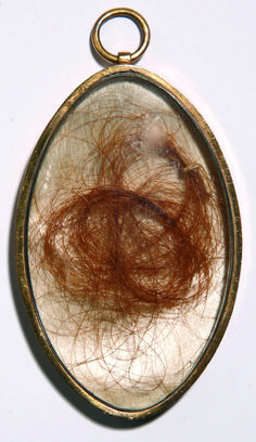 Hair of Mary Tudor in a Gold Locket; Engraved on the back: 'Hair of Mary Tudor Queen of France cut from her head Sep 6 1784 when her tomb at St Edmundsbury was opened H[orace].W[alpole].' From collection of Horace Walpole, Strawberry Hill.