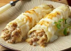 Baked Cannelloni....  Your favorite cannelloni shells are filled with onions, mushrooms and Italian Sausage. The sausage provides an extra boost of delicious Italian flavors. A fantastic white sauce is used along with mozzarella and parmesan cheeses to finish the meal. When it's all over, you've got yourself a phenomenal meal and a new favorite recipe!