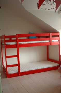 Ikea Mydal bunk bed modified to sit lower to the ground. Great for a room in the eaves.