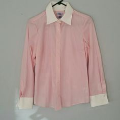 Pink and White Pin Stripe Dress Shirt Size Small IZOD brand. Button down Pin Stripe Dress Shirt. Size Small. Seven buttons down front and two at each wrist. Light pink with white vertical stripes. White collar and wrist cuffs for added style. Pin tuck at bust and along back for a more fitted look. In wonderful condition, Only worn once! No stains, rips, tears, or holes. 55% cotton, 45% polyester. Feel free to ask any questions. MAKE ME AN OFFER! FREE GIFT with every purchase! Bundle for…