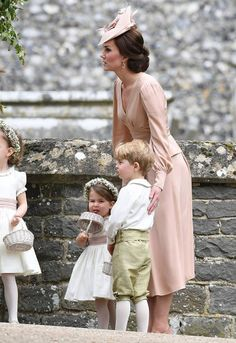 Catherine Duchess of Cambridge with Prince George of Cambridge page boy and Princess Charlotte of Cambridge bridesmaid after the wedding of Pippa...