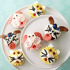 Cat and Dog Cupcakes  Animal lovers will be thrilled to have birthday cupcakes creatively decorated with cut marshmallows, rolled Tootsie Rolls and Starbursts, and piped frosting to look like cats and dogs.