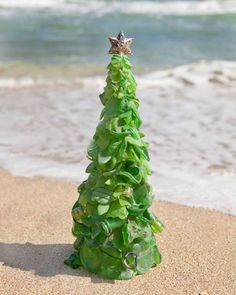#Bermuda sea glass Christmas tree http://foreverbermuda.com/bermuda-sea-glass-makes-unique-holiday-art/