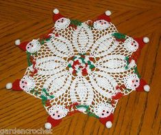 "Watch the Vintage Christmas Doilies Crochet Pattern product review video! Design By: Maggie Weldon Skill Level: Intermediate Sizes: Holly Doily - About 16"" diameter. Green & White Doily - About 11"" di"