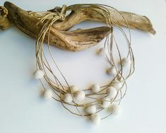 Classy, elegant and minimal necklace, made of tiny cream white felt bals, floated on natural linen cord. Vegan, metal free, with retro romantic natural style its the perfect accessory for woods, garden, farm weddings. You may use it also as a head piece or hair accessory. Length: 19