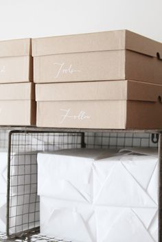Love how neat the storage boxes look. #script #white #labels #kraft #boxes #organized #organization #storage