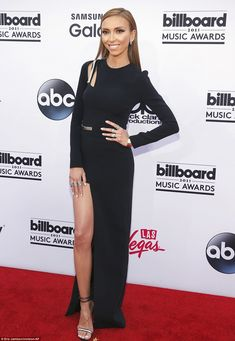 Early bird: One of the first celebrities to arrive at the glitz ceremony was controversial Fashion Police host Giuliana Rancic in a leggy black gown