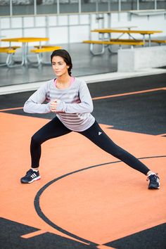 Now, lunge laterally using the same leg by taking a big step out to the right and hinging at the hips to lower. Aim to get your right thigh parallel to the floor. Then, push through the heel of your right foot to return to standing.