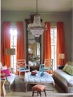 love the feel of the hermes orange in the room-brings so much life and sophistication for the perfect simplicity of the room