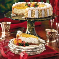 Ambrosia Cheesecake ~ in an almond shortbread cookie crumb crust, finished w/fresh orange curd & toasted coconut   recipe from Southern Living via MyRecipes