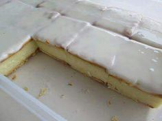 MICROWAVE CUSTARD SLICES Mix 1 cup sugar & 125ml custard powder.Add 1 litre milk & mix well. Add 80ml butter & 20 ml vanilla essence, microwave for 10 min on high. Whisk every 2 mins with metal whisk. (Custard ready when mixture makes patterns when whisking) Line bowl with cream crackers.Pour custard  over crackers & add another layer of crackers on top of mixture. Let it cool. Mix 1 cup icing sugar with 1tbsp boiling water & some lemon juice. Spread  over crackers. Let it set & enjoy!