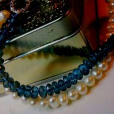 Blue sapphire and freshwater pearl bracelet  for under $30.00.  Email me if you would like more information.