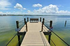 Premium peaceful immaculate Anna Maria Island vacation rentals studio to 4 bedrm. Fish off our dock just steps away on one side (fishing gear incl) & enjoy our white sand beach steps away on the other side! Beach cart/towels/ umbrella/chairs incl. Full kitchens & washer/dryer. Easy walk to all the fun activities/restaurants on & around historic Bridge st.
