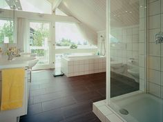Huf Haus - Unfussy tiling carried on throughout.