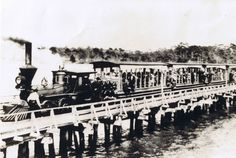 Shown on the trestle from Indian Rocks, this little SAL locomotive pulled tram cars for local visitors to what was then called Indian Beach. The Biltmore Hotel found it especially handy for transporting their guests to the beach. Courtesy Indian Rocks Historical Society