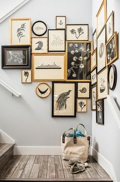 A stair landing is the perfect spot for a salon wall that wraps around a corner. nice touch!