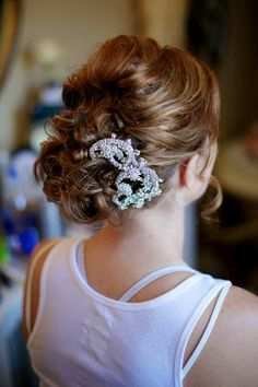 bridal updo with awesome vintage rhinestone hair comb attachment!! no veil. all up. curls, loose bun, center back. red copper hair