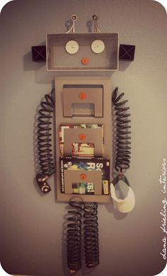 Very cool but knowing my son he would destroy it:(  DIY Robot Surprise.  An awesome idea for a boys room - robot organizer. ~s~