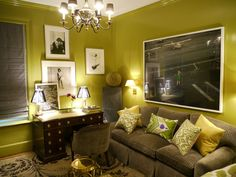 Amanda Nisbet's apartment, In the study, fabrics and furniture pop off the lacquered walls painted in 'Jalapeno Pepper' from Benjamin Moore.