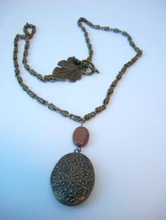 Oval Brass Locket Necklace with Red Picasso by KristasJewellery, $20.00