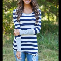 Striped side button top! Stripped blue and white top, with gray accent sleeve, and cute button details that adorn the bottom. Soft, stretchy material. Bust measures 36, length  26. trades. I do not negotiate in the feed.  Boutique Tops Tees - Long Sleeve